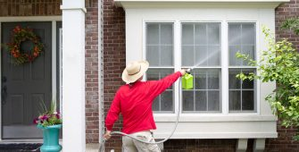 Man Spring Cleaning Home Exterior