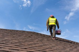 Roofing Professional Performing Residential Roof Inspection
