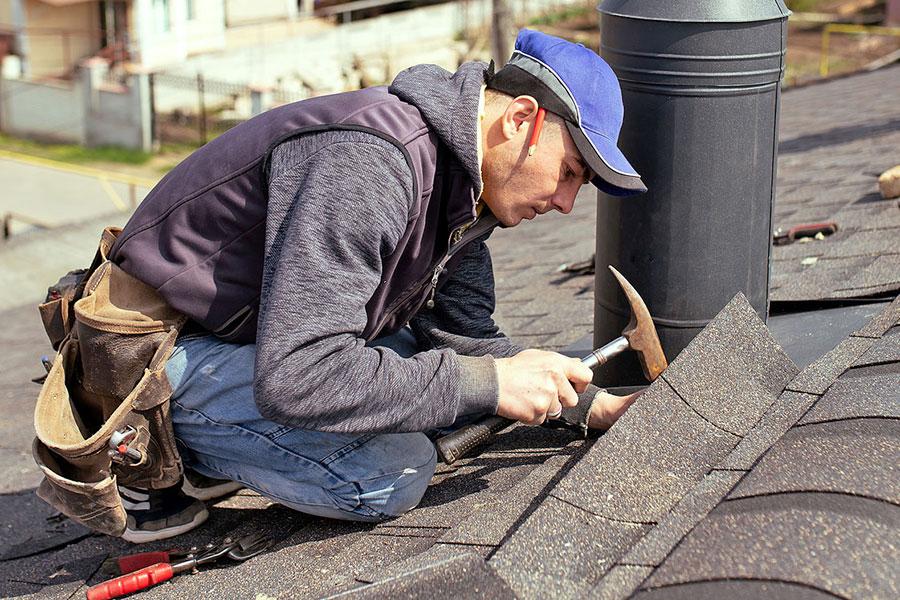 Roofer Performing Shingle Repair